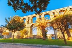 Ancient aqueduct landmark in Kavala city, Greece. Kavala is famous greek summer resort.