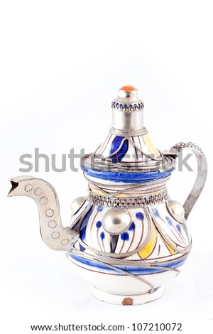 Ancient arabic ornamental teapot on white background