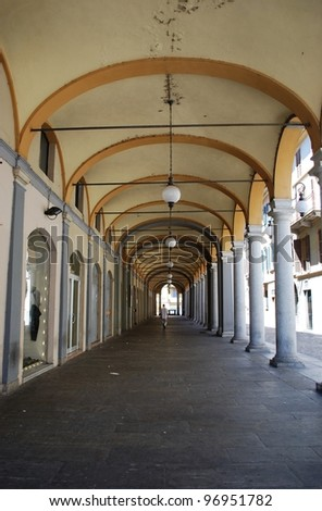Ancient arched portico in town center, Novara, Piedmont, Italy