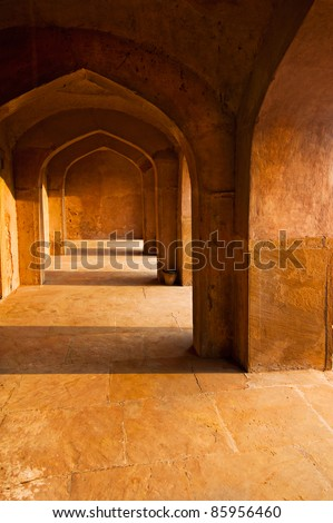 Ancient architecture. India, Delhi. Corridor with arches constructed from terracotta stones
