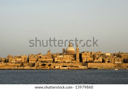 ancient architecture of malta island at sunset - stock photo