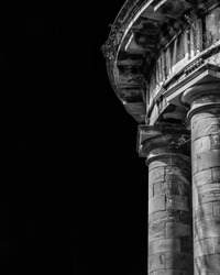 Ancient architecture. The stone temple-cistern of Lucca old aqueduct ruins with doric columns built in neoclassical style in 1823 (Black and white with copy space)