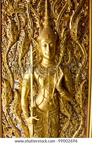 Ancient art pattern on the wooden door in Thai temple - stock photo