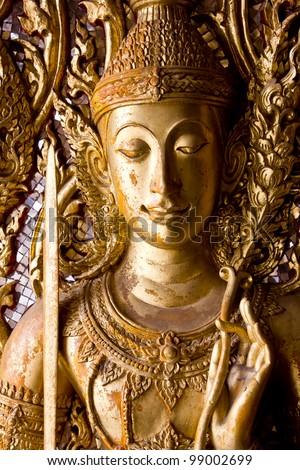 Ancient art pattern on the wooden door in Thai temple