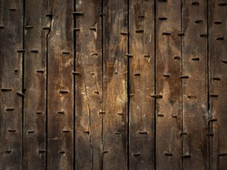 Ancient background of antique oak gate of Rumeli fortress, medieval citadel of ancient Constantinople. Vintage wooden door as grunge backdrop with rusty iron nails.