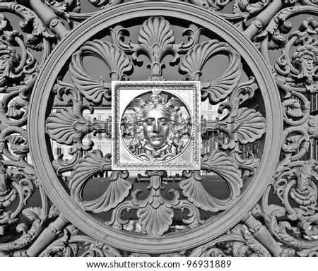 Ancient baroque golden mask on Palazzo Reale (The Royal Palace) fence in Turin Italy
