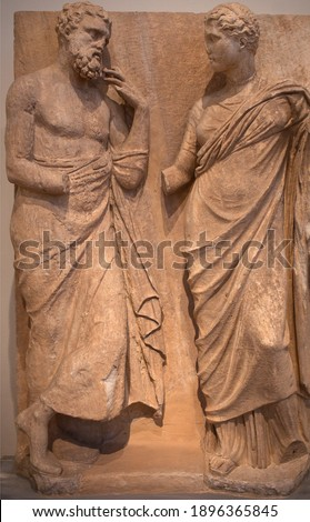 Ancient bas-relief on funerary stele from Kerameikos in Athens, Greece depicting standing man and woman. Stockfoto ©