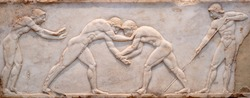 Ancient bas-relief on grave stele in Kerameikos with scene from Palaestra - wrestlers in action. On the left an athlete is ready to jump, on the right another one prepairing the pit. Athens, Greece