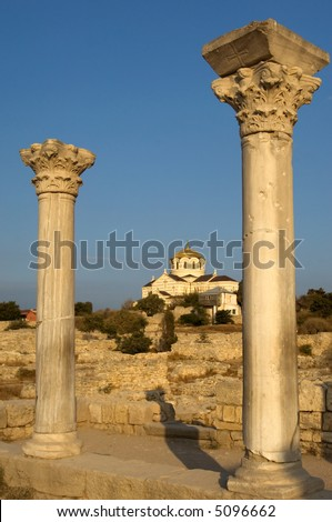 Ancient basilica columns of Creek colony Chersonesos with the view of St. Vladimir's cathedral, Sevastopol, Crimea, Ukraine