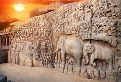 Ancient basrelief of Elephants and another hindu deities at sunset sky in Mamallapuram, Tamil Nadu, India