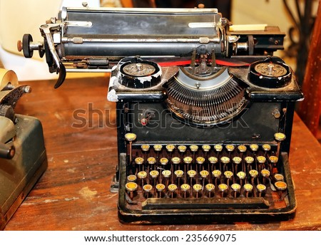 ancient black rusty typewriter with round  keys #235669075