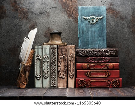 Ancient books, manuscripts and an antique inkwell on a shelf #1165305640
