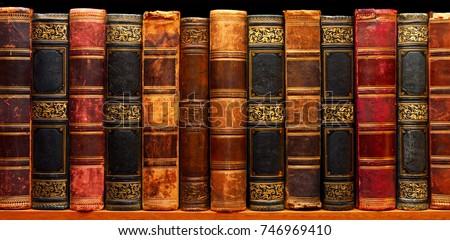Ancient books on shelf in the library