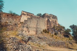 Ancient brick wall and Ruins of Ramkot fort in Kashmir, Pakistan. Which showcases the rich history of India, Ancient Civilization and the Vintage Architecture