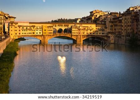 Ancient bridge Ponte Vecchio in Florence at sunset time. Italy.