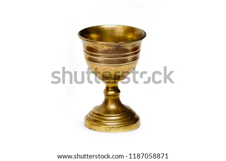 Ancient bronze chalice isolated in white background #1187058871