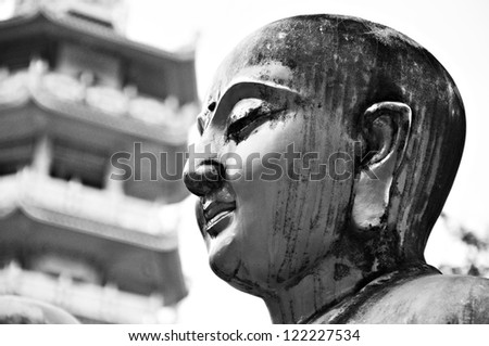 Ancient Buddha face statue in Chinese temple