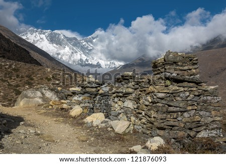 Ancient buddhist stupas with peak Ama Dablam (6814 m) on background - Everest region, Nepal, Himalayas