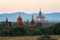 Ancient Buddhist temples at sunset in Old Bagan, Myanmar (Burma).