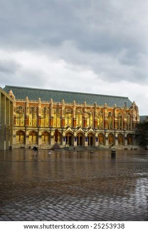 Ancient building of university library under an autumn rain