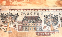 Ancient byzantine natural stone tile mosaics with house and orange trees, Madaba, Jordan