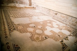 Ancient byzantine natural stone tile mosaics with with geometric patterns, Mount Nebo, Jordan, Middle East.