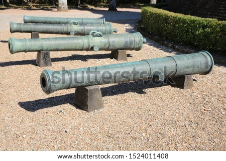 Ancient cannons in a park, Burgundy, France #1524011408