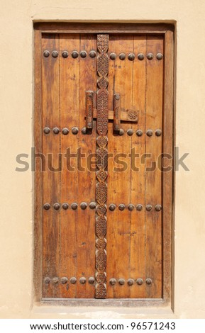 Ancient carved door in Riffa fort, Bahrain