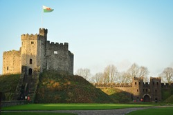 Ancient Castle and flag of Cardiff, Wales, United Kingdom