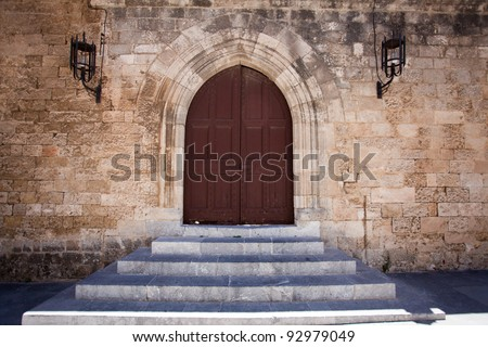 Ancient castle door at the Grand Master Palace in Rhodes town, Greece.