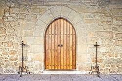 Ancient castle door at the Palace of the Dukes of Braganza, Guimaraes, Portugal