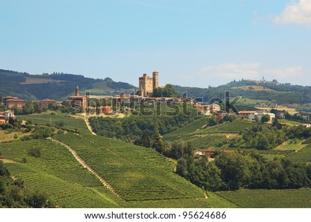Ancient castle of Serralunga D'Alba and small town on top of the hill among vineyards in Piedmont, Northern Italy.