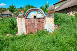 Ancient Cellar for storing wine , exterior view . Old rural cellar with wooden door