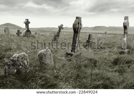 Ancient Celtic gravesite with unmarked gravestones from the 1600's in the middle of a meadow in rural Scotland. - stock photo