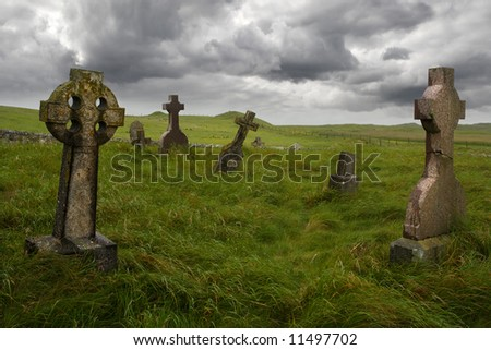 Ancient Celtic gravesite with unmarked gravestones in the middle of a meadow in rural Scotland.