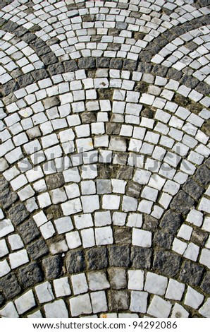 Ancient ceramic tiled decorative stone walkway.