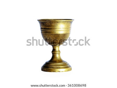 Ancient chalice of copper on white background