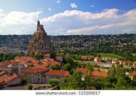 Ancient Chapel Saint Michel de Aiguilhe standing at a very steep volcanic needle (Le Puy en Velay, France)