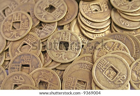 Ancient chinese coins laid out in a pile