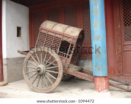Ancient Chinese Rickshaw on display in Xian, China