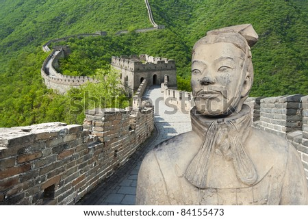 Ancient Chinese terracotta warrior against Great Wall background (wonders of the world and the two major creations of the first emperor Qin Shihuang)