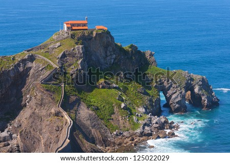 Ancient church,chapel on an island hill, Basque Country, Spain