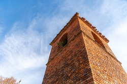 Ancient church tower architecture built of baked bricks. Construction. Medieval construction technique. Temples and churches. Old Catholic church tower in southern Brazil.