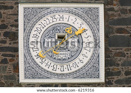 Ancient clock on a tower of the medieval castle