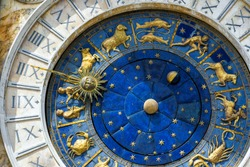 Ancient clock Torre dell'Orologio in San Marco Square, Venice, Italy. Nice detail with Zodiac signs. Historical landmark and travel attraction of Venice. Astrological vintage clock in Venice close-up.