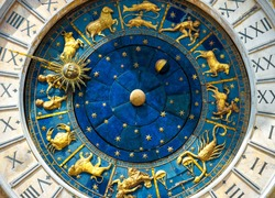 Ancient clock Torre dell'Orologio on St Mark's Square (San Marco) in Venice. Detail with clock face and astrological Zodiac signs. Vintage dial close-up, medieval art of Italy. Astrology concept.