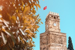 Ancient Clock Tower building in Antalya tourist resort. Architecture and travel destinations in Turkey