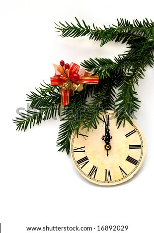 Ancient clock with fir branch and red toy bow on it - a Christmas and new year decoration