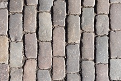 Ancient cobblestone chisel made of boulders