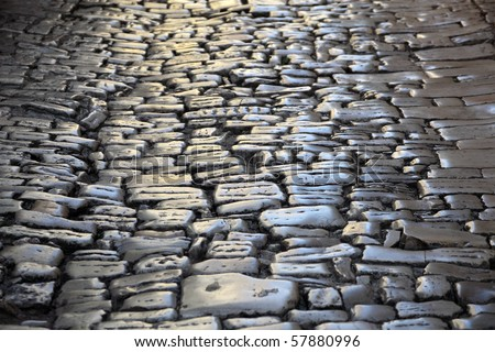Ancient cobblestone pavement in the old town of Rovij, Croatia